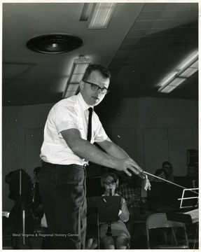 Band director Budd Udell conducting.