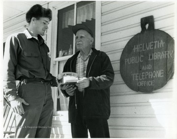 Herman Schneider and man on Helvetia library porch.