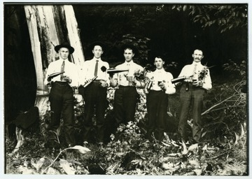 """Gimmel and Marti boys enjoy a Sunday beer."" Left to right: Ernest Gimmel, Simon Gimmel, Leonard Marti, John Gimmel, Gottfried Gimmel."