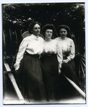 Left to Right: Mini Haslebacher, Olga Aegerter, Lena Haslebacher. Sitting on a horse-drawn hay rake.