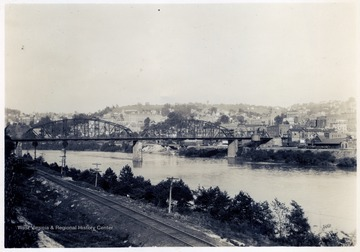 Looking N.E. of Monongahela River Bridge connecting B.&O. and M.R. Depots - Also West Virginia University Buildings