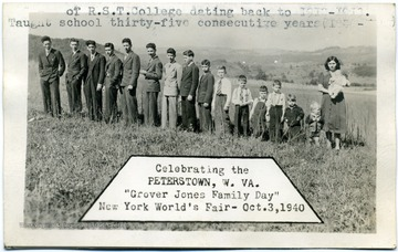"A postcard photograph of a group of unidentified children and young adults standing in line according to height. Inscribed on the back, ""Professor Grover C. Jones""."