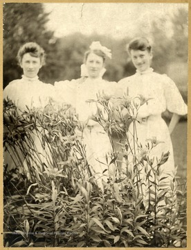 Three sisters, posing in a garden, all became teachers.