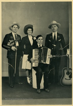 """Brother Cy is at the left next to his is ""Chickie"", then Marion Martin with his accordion and the sad looking fellow with the guitar is yours truly-- Doc Williams."""