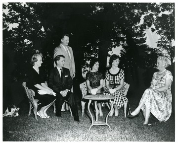 "Gathering for the first production of ""Anvil"" in Charles Town, W. Va. for the West Virginia Centennial. Identified in the photograph: left Seated, Erma Ora Byrd and Robert C. Byrd; far right seated, Julia Davis Adams. ""The Anvil"" was a play written by Julia Davis about the John Brown Raid for the Civil War Centennial. Her grandparents were from Charles Town where Brown was tried and hanged. Her grandfather witnessed the execution."