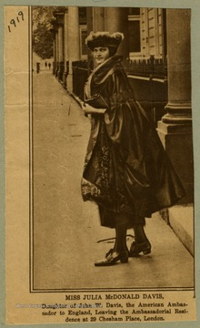 Daughter of John W. Davis, the American Ambassador to England, leaving the Ambassadorial Residence at 29 Chesham Place, London.