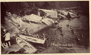 "Bathing beach over Cheat. From the pamphlet ""Morgantown West Virginia Past and Present with a Glance to the Future."""