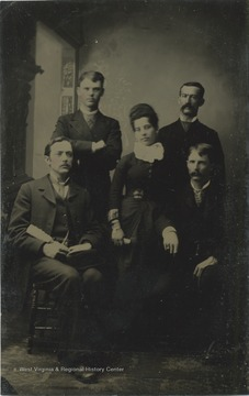Group portrait of Braxton Davenport Gibson (sitting, left) of Charles Town, West Virginia with three men and a woman.
