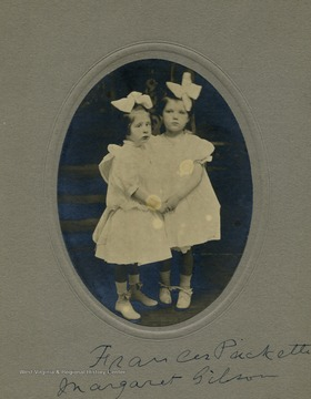 Two girls, Frances Packette and Margaret Gibson, holding hands.