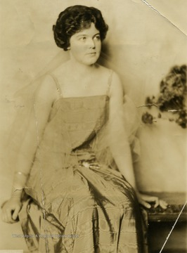 Miss Frances D. Packette posing in evening wear.