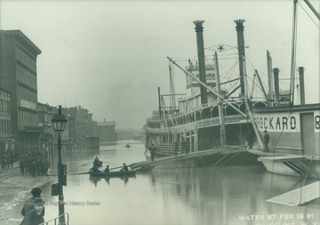 "The ""Ben Hur"" tied up on Water Street during the flood of 1891. The steamboat packet sank in 1916 on the Mississippi river."