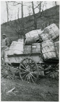 Weekly wagon load of beer bottles and barrels returning from South Sabraton. Listrava Avenue on deep, muddied road.