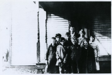 A group of Mt. View School students stand in front of the school house with their teacher, Joseph Lyons.
