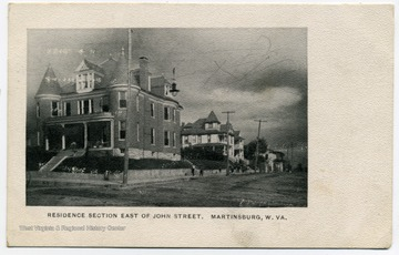 Postcard print of large homes with several turrets, window dormers and chimneys.