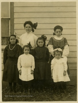 "Post card print of unidentified children. Inscription on the back ""For Grandma Haldeman, from Mrs. Smith"""