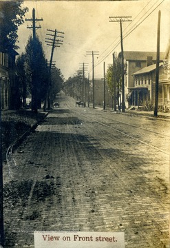 Note the brick paved road and the tracks for the street cars. Front Street is now University Avenue.