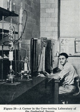 Unidentified researcher observes testing in a lab of the Department of Geology.