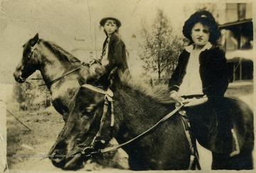 Rebecca Wade, left and Margaret Mathers, right, riding horseback.