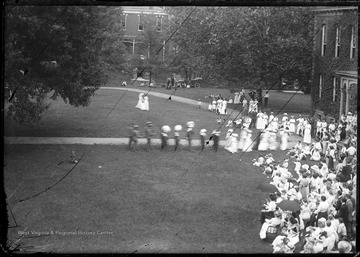 Crowd gathers for the ceremony inaugurating Thomas Hodges as President of West Virginia University. Among the distinguished guests was United States President William H. Taft.