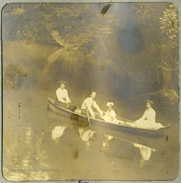 Anna Mathers, wife of Max Mathers, their daughter, Margaret and Stella C. DeGant, Anna's sister enjoying a boat ride on the Cheat River.