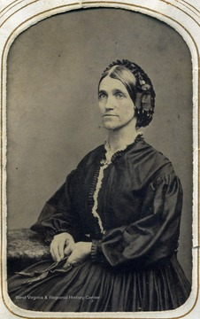 "Portrait of the sister of Thomas Jonathan ""Stonewall"" Jackson. The siblings became estranged after the Civil War broke out. Laura's large sleeve dress and pulled back hair were the fashion during the war."