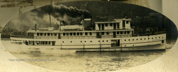 Steam towboat made by Charles Ward Engineering Works of Charleston, West Virginia. Note behind the boat, on the bank, left is the Ward Boilers Factory and on the right is the South Side Foundry.
