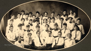 First two back rows: 1.Minnie Goff, 2. Carolyn Bender, 3. Margaret Townsend, 4. ___ Weese, 5. Blanche Barnes, 6. Lilian Smith, 7. Clara Ellison, 8. Mary Cocker, 9. Ella Turner, 10. Ella Comley, 11. unidentified, 12. Eva Hall, 13. Nan Cox, 14. Rachel Whitham, 15. Trace Yoke; Row 3: 16. Unidentified, 17. Jessie Jenkins, 18. Jessie Boyd, 19. Unidentified, 20. __ Hall, 21. Rose Stephens, 22. Laura Strickler, 23. ___ McMillan, 24. Nettie Maxwell, 25. Ethel Jones, Row 4: 26. Marg Mestragat, 27. Etta Willis, 28. Anna Long, 29. Crystal Courtney, 30. Ethel Corle, 31. Laura Lewis, 32. Jessie Madera, 33. Louise Stone; Front Row,Row 5: 34. Gertrude Winter, 35. Blanche Lazzell, 36. Bertha Smith, 37. Besse Sadler, 38. Alberta Baumgardner, 39. Carolyn Schmidt