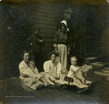 Blanche Lazzell of Maidsville, West Virginia poses with her family on the lawn.