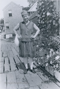 Blanche Lazzell poses outside her studio on the Massachusetts shore, wearing the bathing suit fashion of the day.