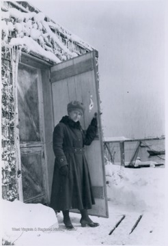 Blanche Lazzell from Maidsville, Monongalia County, West Virginia, standing outside her studio door located on a pier above the beach.