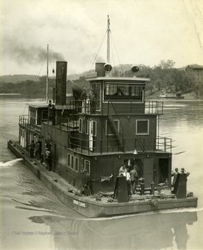 "The Ship ""Dwight F. Davis"" sails through the water. This ship was built by The Charles Ward Engineering Works in Charleston, West Virginia."