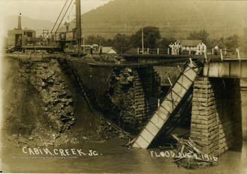 "Postcard photograph of a railroad bridge destroyed by the flood waters of Cabin Creek. Information on the back: ""Hinton Daily News Collection, John Faulkner Collection; from Jim Pettrey to Stephen Trail, 1997""."