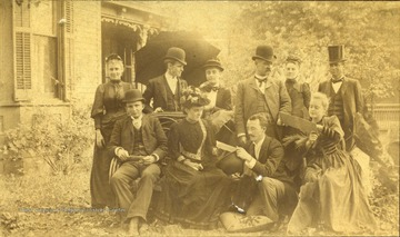 Front Row Left to Right: Mrs. Woolfe; Edd Knight; James Ewing; Miss Etta Hayes; Back Row, L to R: Miss Gypsie Fleming; W. D. Payne; S. S. Green; Mrs. S. S. Green; Miss Ida Fleming; Governor A. B. Fleming. The photograph was taken at S. S. Green's house on Broad Street in Charleston, West Virginia