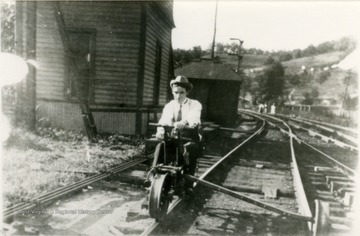 Andrew Rush rides a hand operated rail cycle, also known as a velocipede, at the Chesapeake & Ohio Depot.