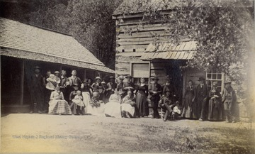 Group portrait of several families of the workers building the Ohio Extension of the Norfolk and Western Railroad along the Tug Fork and Big Sandy Rivers.