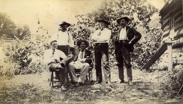 Only identified man is Herbert S. Thomas Sr., seated on the right.