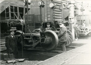 "Train maintenance workers L to R : A. C. Via, Noah Richmond, ""Big Boy"" Karnes"