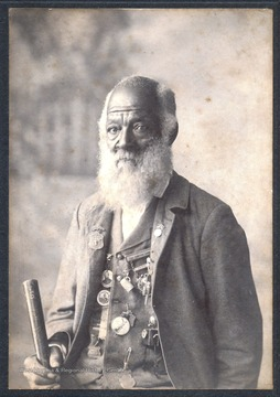 "Shields was the body servant of Colonel James Kerr Edmondson, Company H, 27th Virginia Infantry, ""Stonewall Brigade"" during the Civil War. Shields, shown here wearing several medals awarded to him by Confederate Veterans Groups, claimed to have also cooked for General Thomas ""Stonewall "" Jackson."