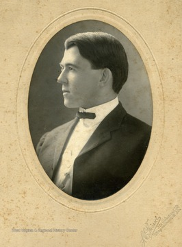 "Inscribed on the back of the photo is ""L.A. Burns, a school man"""