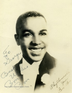 "Bon Bon played at the Stanley in Pittsburgh. He was a vocalist with Jan Savitt, who he left in October of 1940 to create his own orchestra. The photo was collected by George and Mike Barrick, two WVU students. The photo is inscribed with ""To George Best Wishes Bon Bon"""