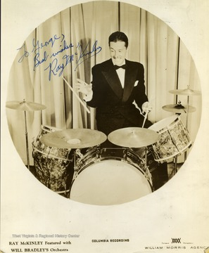 "This photo was collected by George and Mike Barrick, two WVU students. He performed at The Met. in Morgantown as part of Will Bradley's orchestra. The photo is signed ""To George Best Wishes Ray McKinley"""