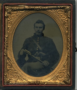 Either an ambrotype or tintype image of G. P. Gardner wearing an officer's uniform of possibly the Union Army,and holding a sword with a revolver tucked in his belt.