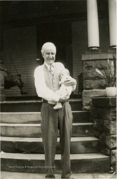 This is a photograph of Max Mathers and his great-grandson George M. Barrick III in Morgantown, West Virginia.