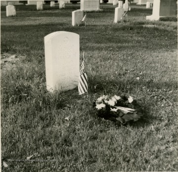This is a photograph of the grave Lt. George M. Barrick Jr. He is buried in Arlington National Cemetery in Washington D.C.