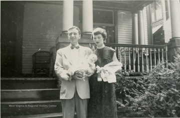 This is a photograph of George and Sarah Barrick. George is holding their son George Barrick III. They are in Morgantown, West Virginia.