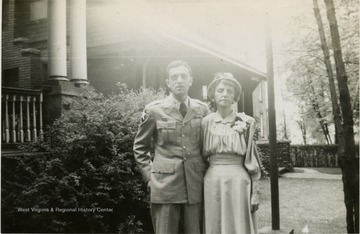 This is a photograph of Lt. George M. Barrick. He is standing with his mother Margaret M. Barrick in Morgantown, West Virginia.