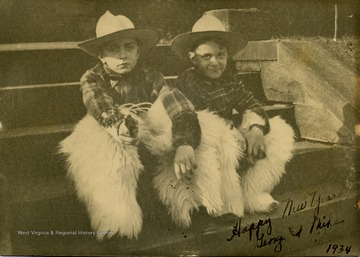 "Inscribed on photograph, ""Happy New Year, George and Mike""."