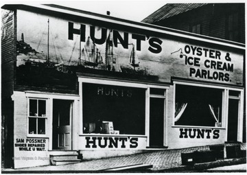 "John Hunt was an African American businessman who operated several resorts, hotels and eateries in Morgantown. He opened Hunt's Oyster Parlor for Ladies at 127 Walnut Street. He was best known for his ice cream factory located on the corner of Hough Street and Beechurst Avenue. It was the first ice cream plant in Monongalia County. Information on p. 40,101, in ""Our Monongalia"" by Connie Park Rice. Information with the photograph includes ""Reproduced from the John H. Hunt family photos, held by WVU Women's Centenary Project, Center for Women's Study Archive. Original Loaned by Virginia Hunt Chandler."""