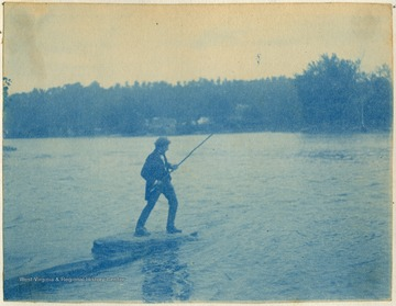 Unidentified man pulls in a catch.
