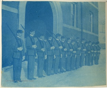 Cadets standing with shouldered arms. All persons in the photograph are unidentified.